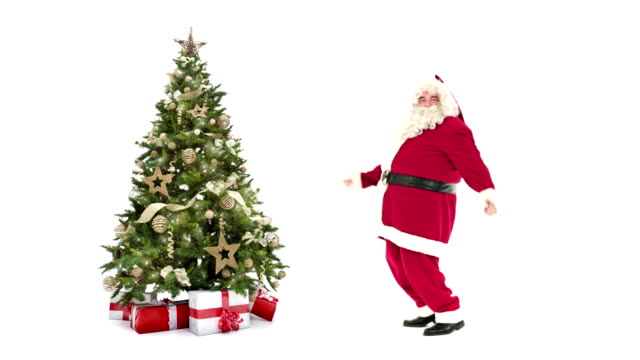 Lights decorated xmas tree with gift boxes and Santa Claus happy dancing on white background with text space to place logo or copy.Animated Christmas present greeting post card video video