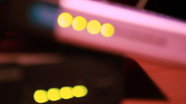 hd: lights on wireless router - intoning bildbanksvideor och videomaterial från bakom kulisserna