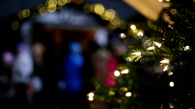 Lights sparkling on decorated New Year tree at Xmas fair video