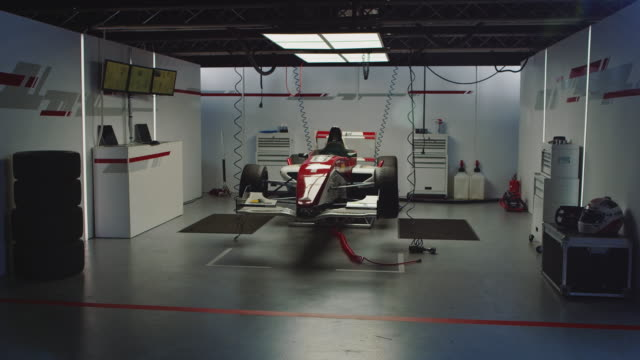 Lights turning on in auto repair shop of racecar