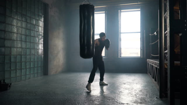 Lightweight boxer training in vintage stylized gym video