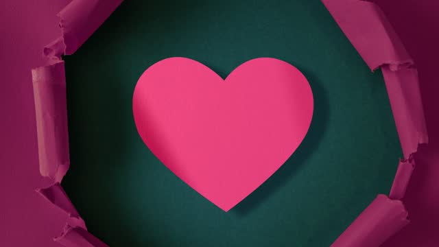 Lilac paper is torn over pink heart on aquamarine background, stop motion, animation. St. Valentine's Day.