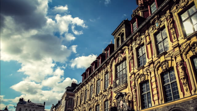 Lille, Hauts de France : classical french architecture time lapse Typical old buildings in the heart of Lille, the largest city of France located North of Paris french architecture stock videos & royalty-free footage