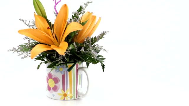 Lily floral arrangement. Left rotating.