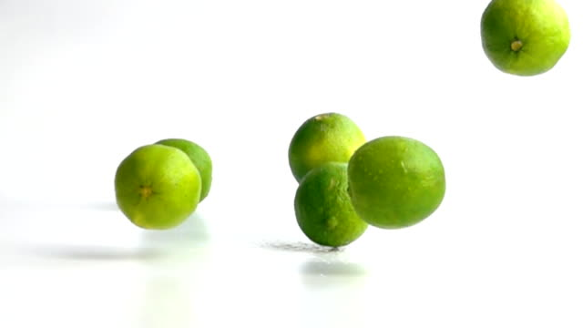 limes falling in slow motion video