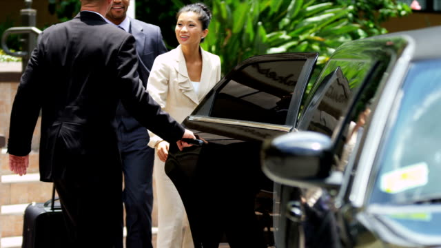 Limousine Chauffeur Meeting Corporate Clients Multi ethnic male female chief executives arriving business meeting being met by company limo driver slow motion shot on RED EPIC luxury car stock videos & royalty-free footage