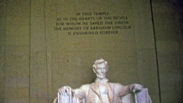 1963: Lincoln Memorial marble carved statue immutable words.