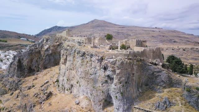 Lindos beach and acropolis Rhodes,Lindos, Greece. Aerial drone shot aegean islands stock videos & royalty-free footage