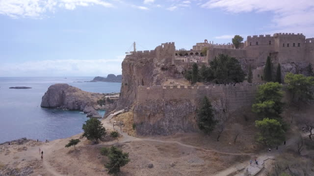 Lindos beach and acropolis Rhodes,Lindos, Greece. Aerial drone shot greek islands stock videos & royalty-free footage