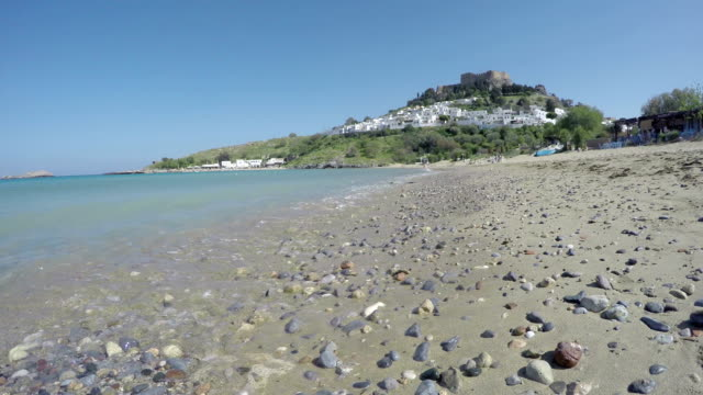 Lindos beach and hill with castle, Rhodes, Greece. Timelapse video
