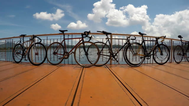 line of bicycles leaning on handrail. video