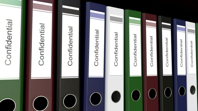 Line of multicolor office binders with Confidential tags. FullHD seamless loop clip video