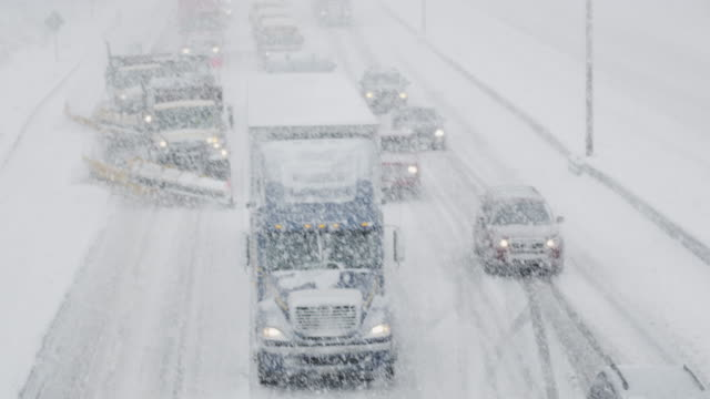 Line of Vehicles Trudging Through the Winter Storm video