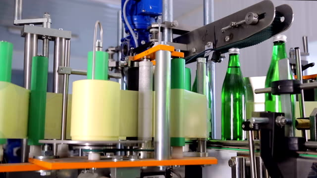 Line of water production. Labeling a bottle video
