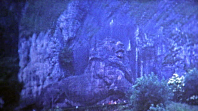 1969: Lion carved into the side of the mountain.