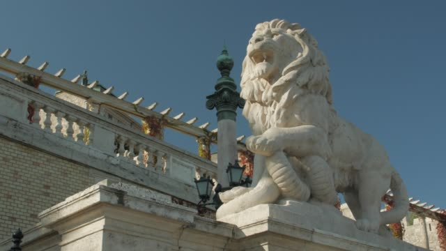 Lion Statue Old Architecture Lion statue old architecture snake monument Castle Garden Bazaar Neo Renaissance style facade exterior Budapest Hungary smooth camera movement hungary stock videos & royalty-free footage