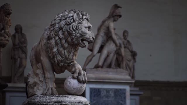 Lions doctors in Loggia dei Lanzi in Piazza della Signoria, main square in Florence, Italy.