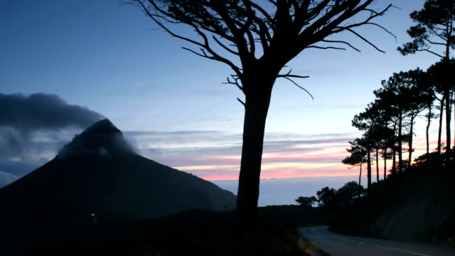 Lions Head at Dusk Time lapse of clouds rolling over Lions Head in Cape Town at dusk, with light streaks of passing cars.  western cape province stock videos & royalty-free footage