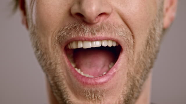 Lips of a laughing Caucasian man with beard video