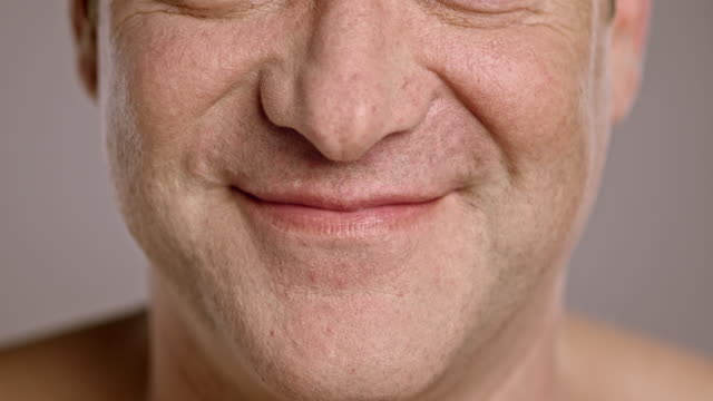 Lips of a smiling middle-aged Caucasian man video