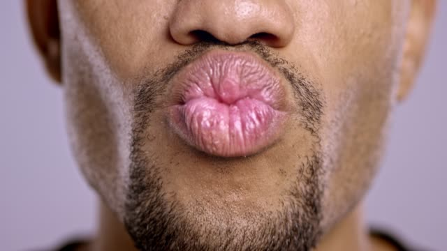 Lips of a young African-American male changing moods