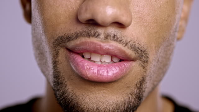 Lips of a young African-American male talking video