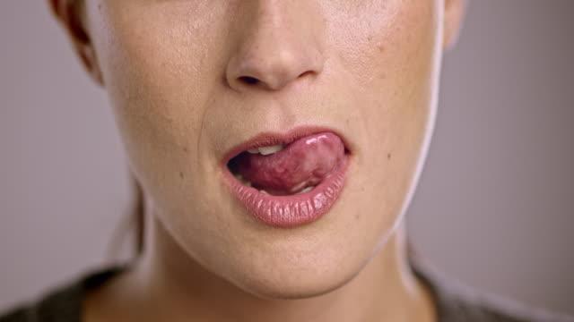 Lips of a young Caucasian woman flirting