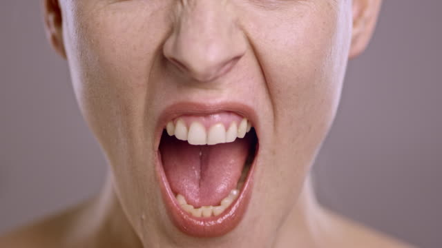 Lips of an angry Caucasian woman screaming in anger video