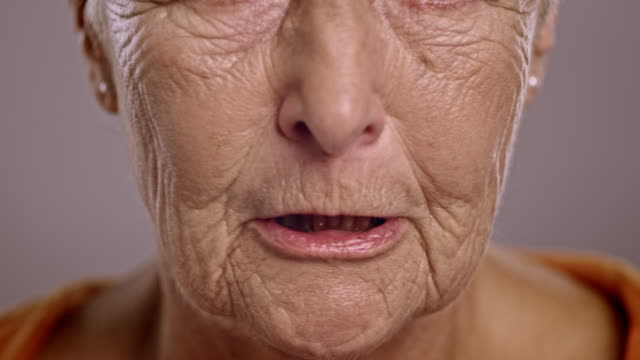 Lips of an angry senior Caucasian woman
