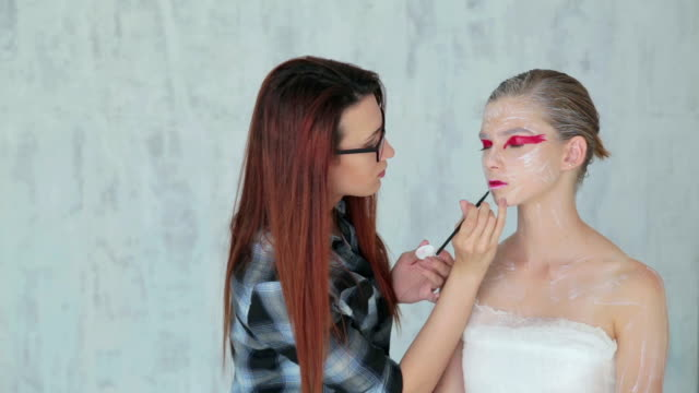 Lips painting: professional make-up artist making face makeup art video