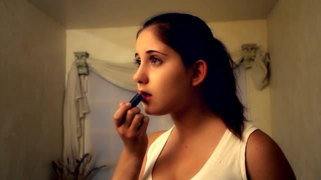 Lipstick Teenager applying lipstick. Canon EOS 7D. lip balm stock videos & royalty-free footage