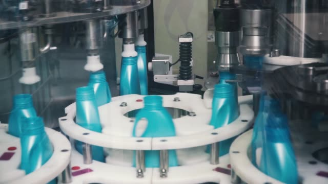 liquid detergent on automated production line. clip. automated production line of washing fluid. machinery for bottling - disinfectant stock videos & royalty-free footage