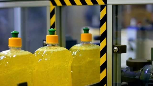 Liquid Detergent Production Line Plastic bottles move along the conveyor belt. Manufacturing of cleaning products. dishwashing liquid stock videos & royalty-free footage