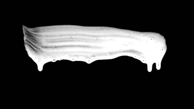 Liquid Paint Brush Realistic paint brush white luma matte on black background for revealing photo or video backgrounds in slideshow or logo reveals. brush stroke stock videos & royalty-free footage