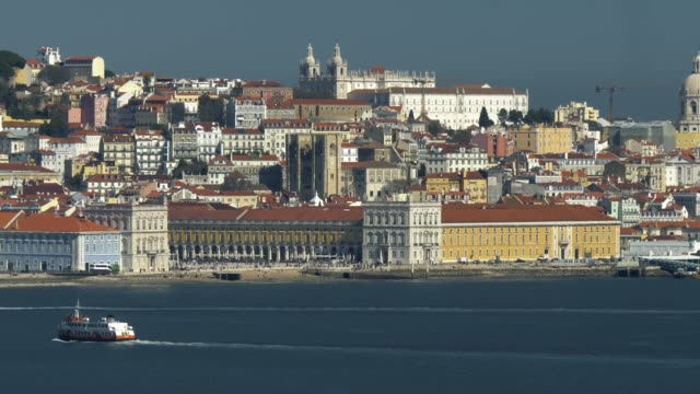 lisbon, portugal. view from the river tagus to the embankment. panoramic shot. 4k, uhd - lisbona video stock e b–roll