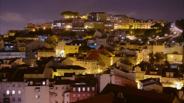 Lisbon Traditional Architecture Hills Cityscape at Night Time Lapse Portugal