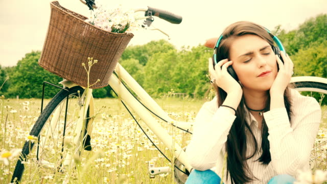 Listening to music, headphones. Bicycle ride rest. video