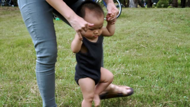 Litle baby boy doing his first steps