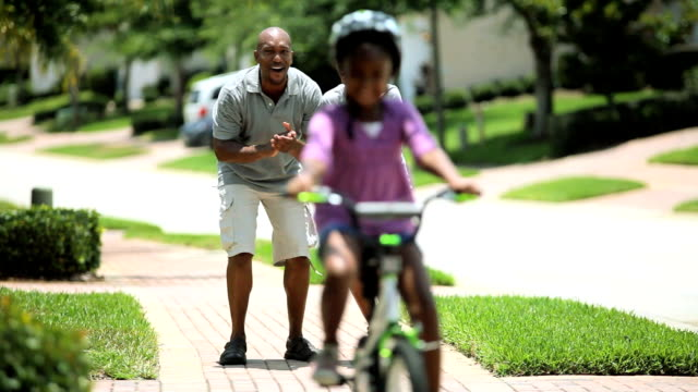 Little African American Girl Learning to Ride a Bike video