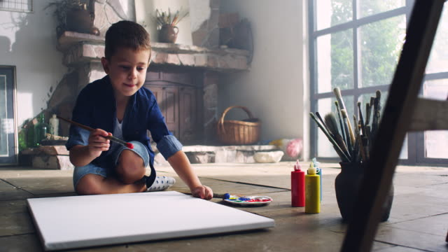Little artist Little boy painting at the artist's studio canvas fabric stock videos & royalty-free footage