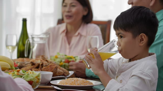 Little Asian Boy Drinking Juice