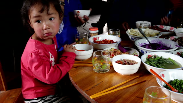 Little Asian girl eating traditional food video