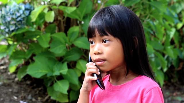 Little Asian Girl Talking On Cell Phone video