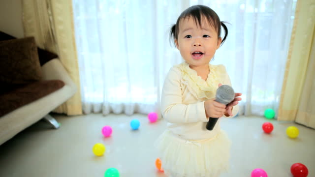 little asian girl with microphone video