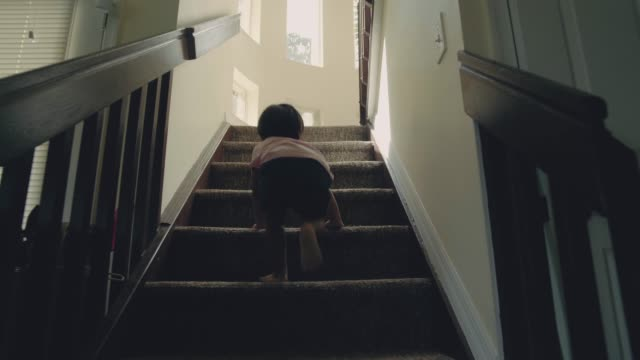 Little baby (24 months) boy climbing up the steps Asian baby (24 months) boy climbing up the steps at home. stimulus stock videos & royalty-free footage