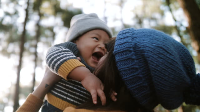 vídeos de stock e filmes b-roll de little baby boy playing with his mother. - segurar