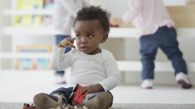 Little baby by at preschool video