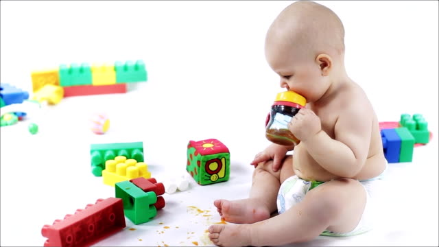 Little baby get dirty of juice. video
