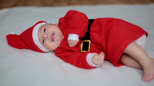 Little baby in Santa's clothing video