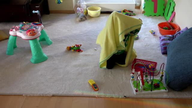 little baby play with wrap at room. happy childhood games. fullhd - rotolo video stock e b–roll